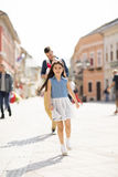 Young father with daughters. Young father with cute daughters on the street stock image