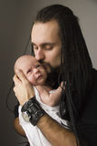 The young father embraces the baby Royalty Free Stock Images