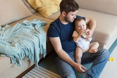 Father feeding baby. Young father feeding his baby with nursing bottle Royalty Free Stock Photography