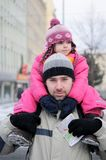 Young father gives his daughter a ride on his back Royalty Free Stock Images