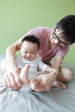 Young Father Happy Play with His Baby. (an asian family) with green home background royalty free stock photography