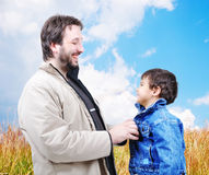 Young father helping his son Royalty Free Stock Image