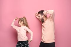 Young father with his baby daughter. Dancing at studio pink background Stock Photography
