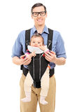 Young father and his baby daughter posing Royalty Free Stock Photography
