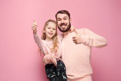 Young father with his baby daughter with thumb up stock photography