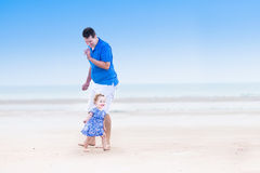 Young father with his cute toddler daughter on beach Royalty Free Stock Photo