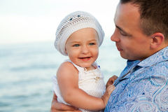 Young father with his daughter on the beach. Royalty Free Stock Photography