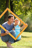 Father with his daughter in the frame Stock Photos