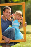 Father with his daughter in the frame Royalty Free Stock Images