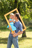 Father with his daughter in the frame Royalty Free Stock Photography