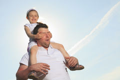 Young father with his daughter outdoor on a summer Stock Photos