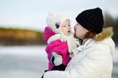Young father and his daughter on winter day royalty free stock photo