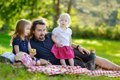 Young father and his daughters having a picnic Stock Photography