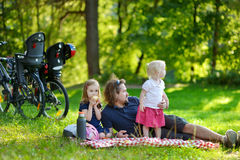 Young father and his daughters having a picnic Royalty Free Stock Photos