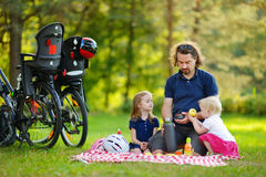 Young father and his daughters having a picnick Royalty Free Stock Image