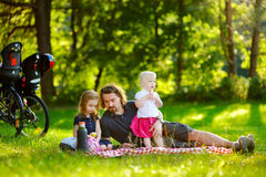 Young father and his daughters having a picnick Stock Images