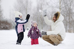 Young father and his girls on winter day Stock Images