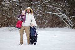 Young father and his girls on winter day Stock Photos