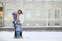Young father and his girls on winter day Royalty Free Stock Photos