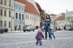 Young father and his girls on winter day Stock Photography