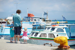 Young father and his kids at fisherman village Royalty Free Stock Images