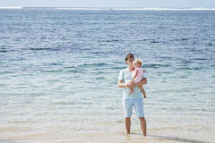 Young father with his little daughter at the beach Royalty Free Stock Image