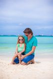 Young father and his little daughter sitting on Stock Photo