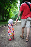 Young father and his little daughter walking Stock Images