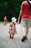 Young father and his little daughter walking Royalty Free Stock Photo