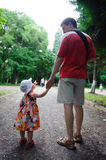 Young father and his little daughter walking Stock Photos