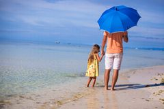 Young father and his little daughter walking under Stock Images