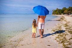Young father and his little daughter walking under Stock Image
