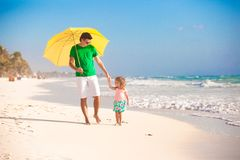 Young father and his little daughter walking under Royalty Free Stock Photo