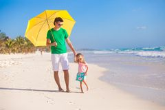 Young father and his little daughter walking under Royalty Free Stock Photography