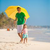Young father and his little daughter walking under Stock Photography