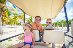 Young father and his little daughters inside golf Stock Photography