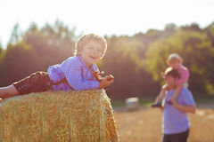 Young father and his little son having fun on yellow hay field i royalty free stock photo