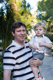 Young father and his little son outdoors. Happy Young father and his little son outdoors, summer Royalty Free Stock Image