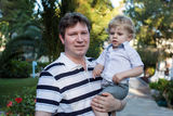 Young father and his little son outdoors. Happy Young father and his little son outdoors, summer Stock Image