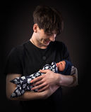 Young father and his newborn baby boy royalty free stock photo