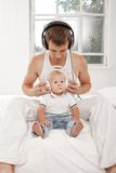 Young father with his nine months old som on the Stock Photography