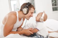 Young father with his nine months old som on the Stock Image