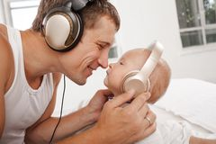 Young father with his nine months old som on the Stock Images