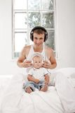 Young father with his nine months old som on the Royalty Free Stock Photo