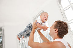 Young father with his nine months old son at home Royalty Free Stock Images