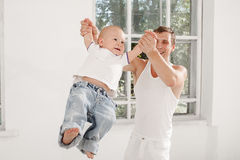 Young father with his nine months old son at home Stock Photo