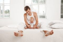 Young father with his nine months old son on the Stock Photo
