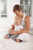 Young father with his nine months old son on the Stock Photography