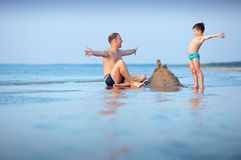 Young father and his son having fun at beach Royalty Free Stock Image