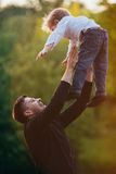 Young father with his son. In park stock image
